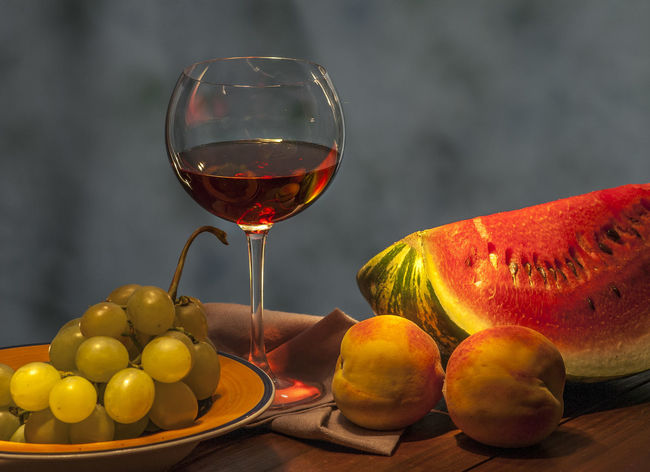 Red winw with fruits Alcohol Close-up Day Drink Drinking Glass Food Food And Drink Freshness Fruit Healthy Eating Indoors  No People Peaches🍑 Ready-to-eat Red Red Wine Refreshment Table Water Melons Wine Wineglass Yellow