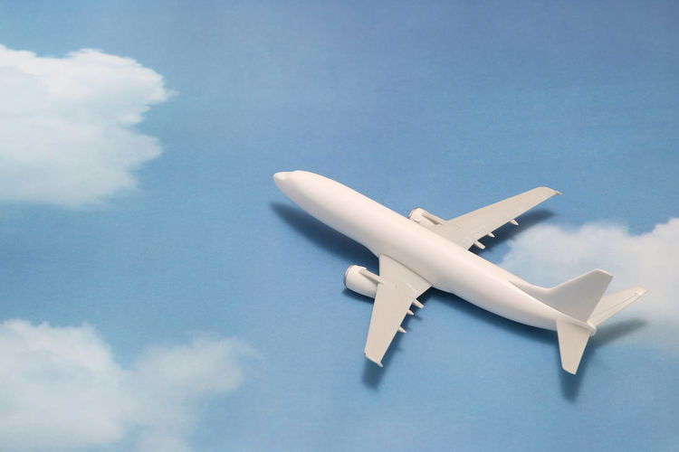 Close-up of model airplane on sky patterned table
