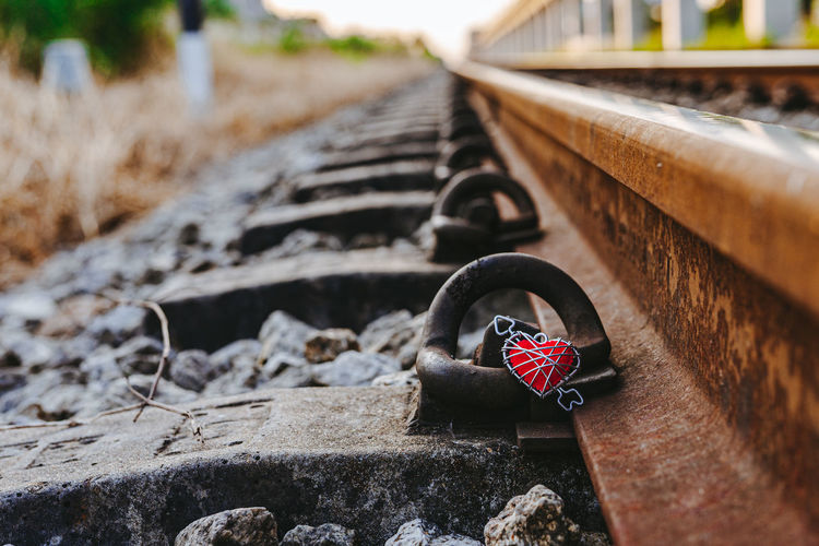 Close-up of heart shape on railroad track
