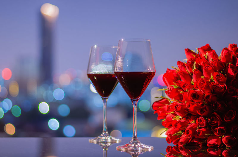 Close-up of red wine on glass table