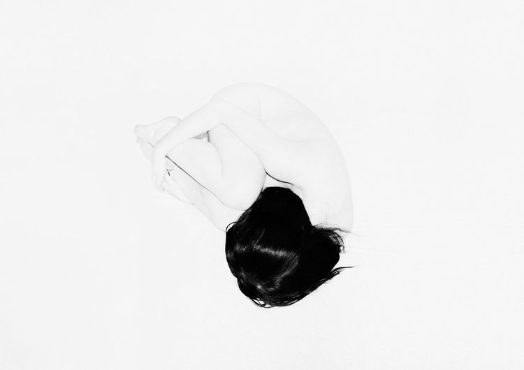 High angle view of woman against white background