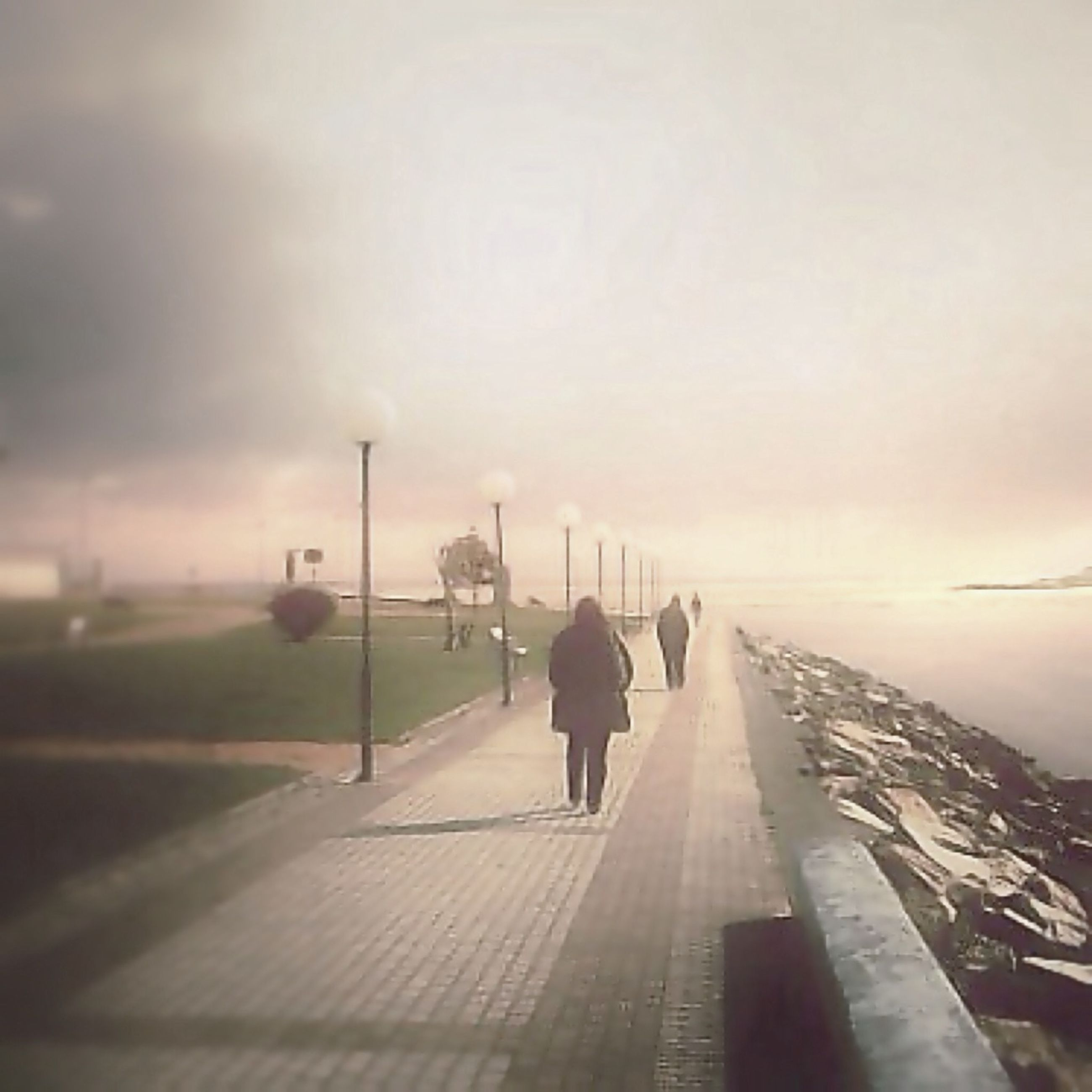 rear view, the way forward, sky, full length, lifestyles, walking, men, leisure activity, transportation, silhouette, diminishing perspective, road, standing, person, vanishing point, cloud - sky, street, weather