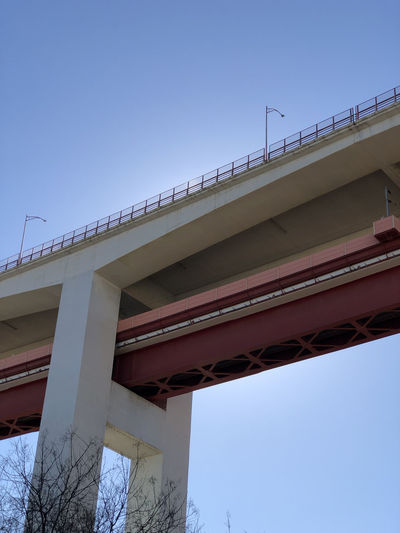 Low angle view of road bridge against clear blue sky in Lisbon, Portugal Lisbon Portugal Built Structure Architecture Sky Low Angle View Clear Sky Bridge Bridge - Man Made Structure Nature Day No People Connection Blue Transportation Architectural Column Building Exterior Outdoors City Overpass Copy Space Road