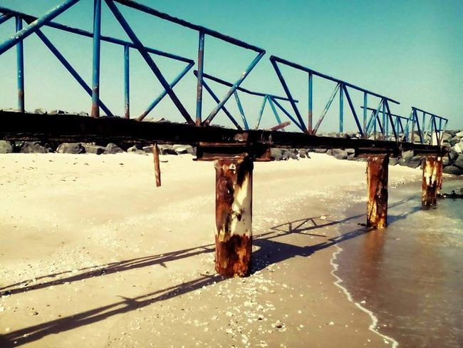 Water Bridge - Man Made Structure Sky Built Structure Day Outdoors Nature Beach Connection Sand Colours Nature Beauty In Nature Excitement Shadow