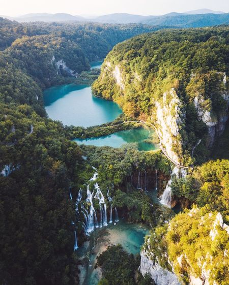 Sun rises over Plitvice Lakes, Croatia. Plitvice National Park Nature Landscape Croatia Water Beauty In Nature Scenics - Nature Plant Tree Tranquility Tranquil Scene Nature Day Non-urban Scene No People Growth High Angle View Mountain Idyllic Green Color Land Sea Outdoors