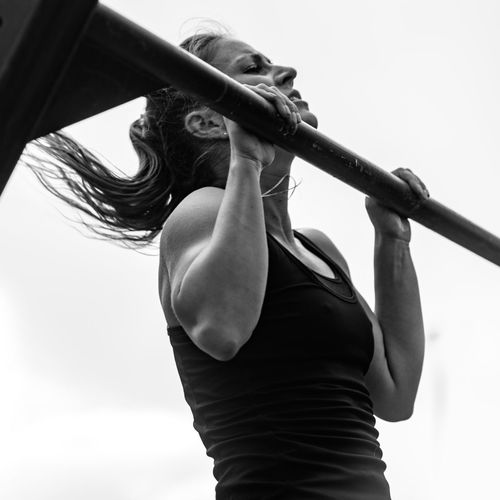 Female Doing Pull Ups On Competition Fitness Cross Training Cross Fit Training Workout Athlete Muscular Competitive Sport Exercising Exercise Equipment Black White Black And White Lifestyle Woman Young Girl Attractive Outdoors Pull Ups Day Sky Square