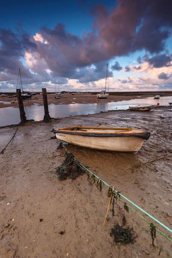 Low Tied Scenics Harbor Rowing Boat Blue Sky Low Tide Sea And Sky Seaside Wells-next-the-Sea Norfolk Nautical Vessel Cloud - Sky Sky Water Moored Transportation Mode Of Transport Beach Tranquil Scene Beauty In Nature No People Outdoors Day Sand