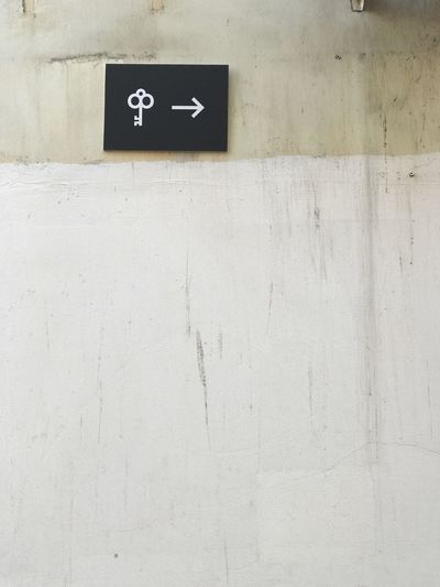 Wall - Building Feature Communication Number Built Structure No People Sign Architecture White Color Day Information Information Sign Symbol Wall