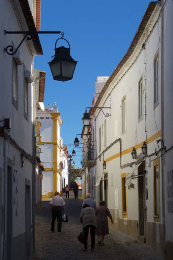 Adult Alentejo Alentejo Landscapes Alentejo 🌞 Alentejo,Portugal Alentejo-Portugal Architecture City City Street Cityscape Day Outdoors People Person Portugal Senior Sky Street Travel Destinations Vertical