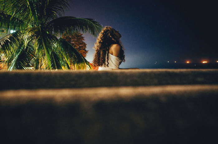 young woman looking into the night sky Breathing Clear Sky Freedom Night Lights Palm Tree Relaxing Rio De Janeiro Woman Beautiful Woman Beauty In Nature Brazilian Clean Air Close-up Into The Night Nature Night Outdoors Palm Tree Relaxation Relaxing Moments Sky