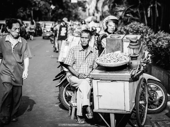 want to buy my hot peanut? Streetphotography Street Photography Streetvendor Old Oldman Oldmanportrait Black And White Photography Black And White Blackandwhite Blackandwhite Photography People The Street Photographer - 2018 EyeEm Awards Men Togetherness Full Length