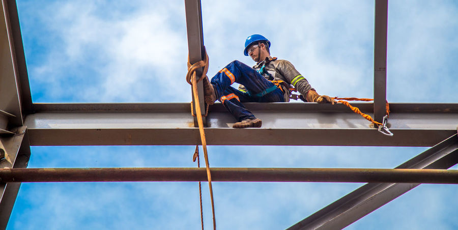 Architecture Built Structure Cloud - Sky Construction Industry Construction Site Construction Worker Day Full Length Industry Ladder Low Angle View Men Nature Occupation One Person Outdoors Real People Safety Harness Sky Working