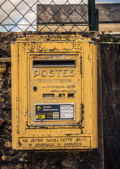 Close-up Communication Correspondence Day France Mail Metal No People Nostalgic  Old Outdoors Public Mailbox Text Vintage Weathered Yellow