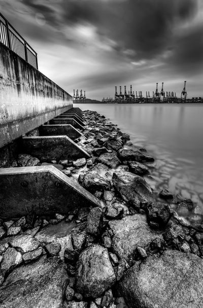 At low tide Architecture Beach Blackandwhite Built Structure Cloud - Sky Day Habor Long Exposure Marina South Pier No People Outdoors River Rocks Singapore Life Sky Visit Singapore Water Your Singapore