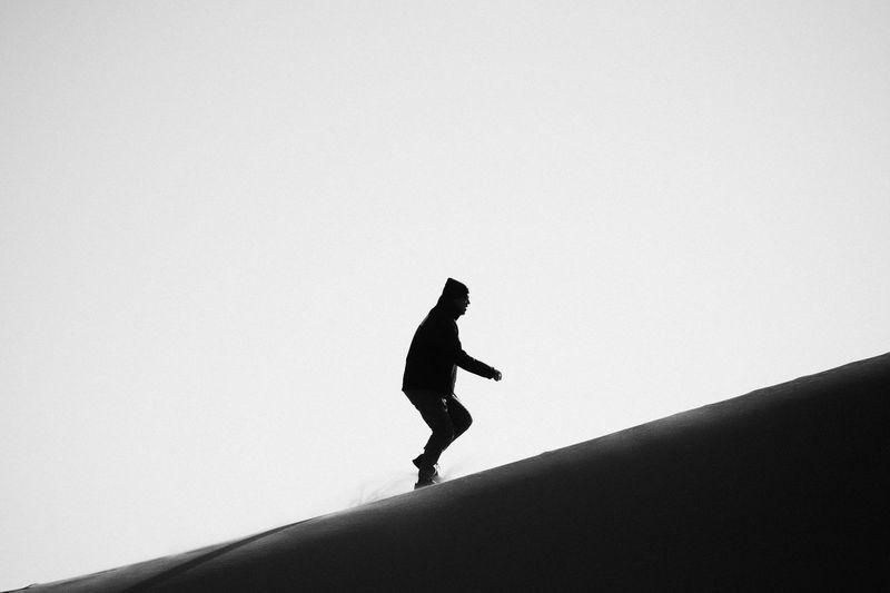 Low angle view of silhouette man against clear sky