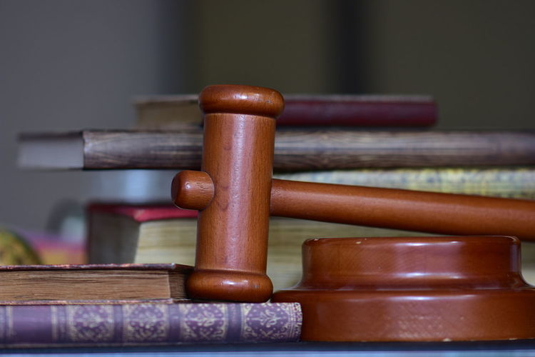 Close-up of books with gavel on table