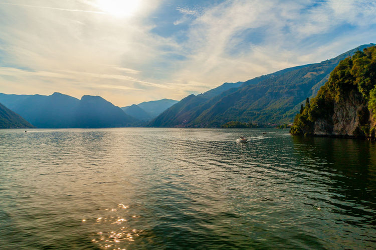 Lansdscape of lake of como from garden of villa del balbianello, lombardy, italy at sunset