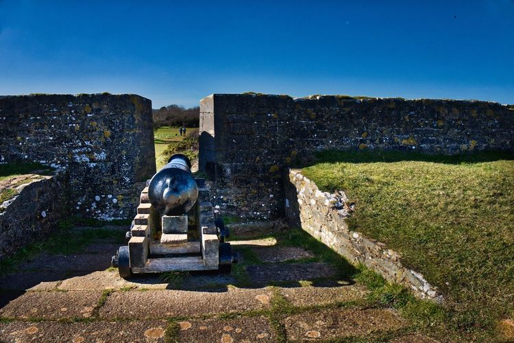 Headland Lookout Battlement Gun Cannon History Art And Craft Statue Stone Material Sculpture No People Ancient Monument Day Outdoors Sunlight Old Ruin Built Structure