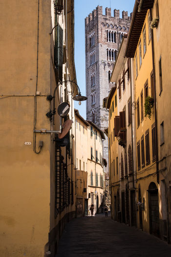 Renaissance Alley Apartment Architecture Building Building Exterior Built Structure City Day Direction Electric Lamp Lighting Equipment Medieval Narrow Nature No People Old Outdoors Renaissance Architecture Residential District Sky Street The Way Forward Town Window Housing Settlement Walkway Astronomical Clock Residential Structure Historic Capture Tomorrow