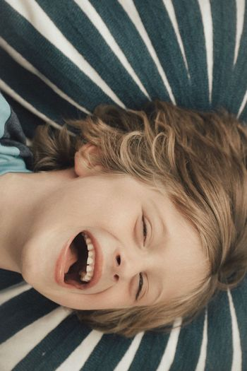 Striped One Person Childhood Indoors  Day Portrait Child Looking At Camera People Close-up Lying Down Real People Young Adult Blond Hair Children Only