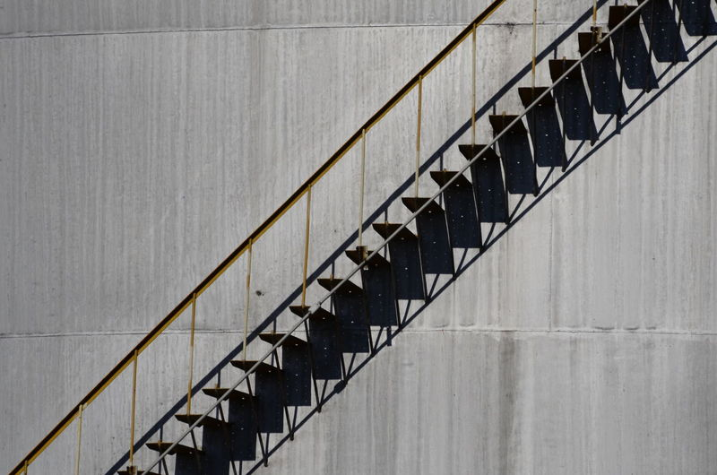Low angle view of spiral staircase against wall