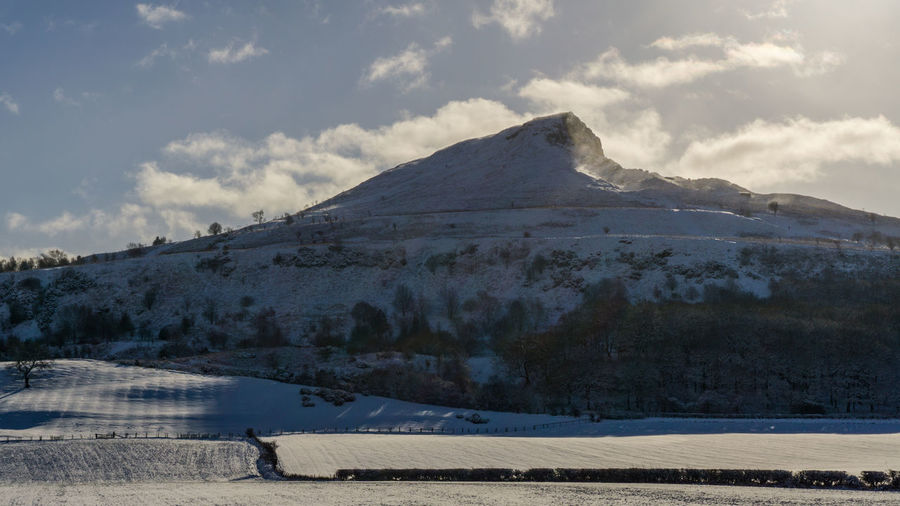 Roseberry Topping. An amazing landmark located in the north east of England. North Yorkshire North North East Yorkshire Roseberry Topping Cliff Mountain Snow Snowing Winter Season  Seasons Frost Frosty Sky Cold Temperature Scenics - Nature Beauty In Nature Tranquil Scene Nature Snowcapped Mountain Tranquility No People Winter Is Coming Wintertime Winter Wonderland Winter Trees Christmas Blue Winter Theme Winter Themes And Images Countryside Winter Country Scene Winter Countryside