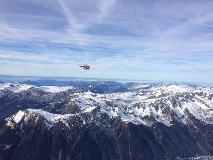 Helicopter Flying Above Snowcapped Mountains At Chamonix