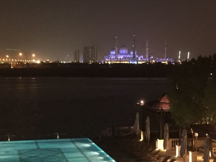 The Grand Mosque, Abu Dhabi Illuminated Night Architecture Built Structure Building Exterior City Calm Water Sky Tranquility Dark Lamp Post Tranquil Scene Outdoors Ocean No People Sea Abudhabi UAE Mosque