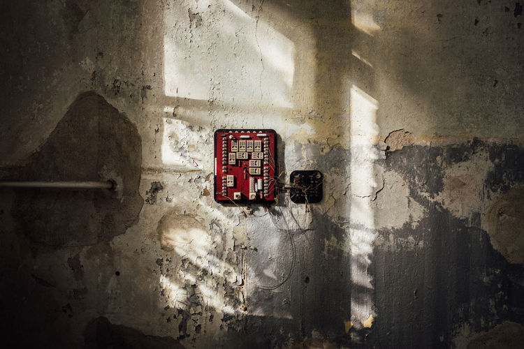Electric Switch Board On Damaged Wall