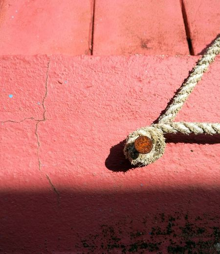 Exploring Style Red No People Close-up Textured  Outdoors Knot Rope Ropes Nail Rusty Wall Bonding Bond Abstract Fine Art Abstract Photography Knots Nailed Nailed It Texture Colorful Bright Colors Object Small Objects