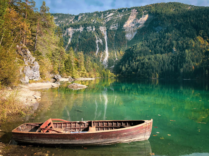 Boat Moored By Lake Against Mountain