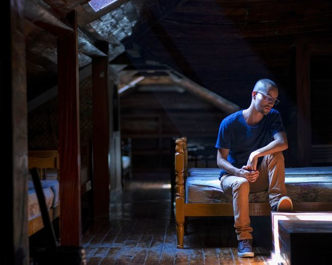 Young man sitting in cabin