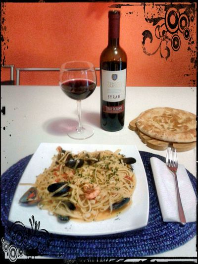Spaghetti with fish and a good red wine.... Enjoying Life That's Me