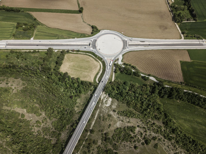 A roundabout photographed from above near the city of Cuneo (Piedmont, Italy) Transportation Road Aerial View High Angle View Landscape Day Environment Mode Of Transportation Outdoors Agriculture Land Land Vehicle Architecture Green Color Dronephotography Drone  Cuneo Piemonte Italy Aerial Aerial Photography Aerial Shot Highway Highway Photography EyeEm Best Shots