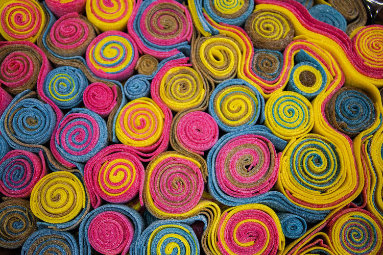 multicolored spiral chewing marmalade Multi Colored Full Frame Large Group Of Objects Backgrounds Variation No People Abundance Choice Close-up Still Life Pattern Textile Indoors  Stack High Angle View Collection Store For Sale Retail  Textile Industry The Foodie - 2019 EyeEm Awards