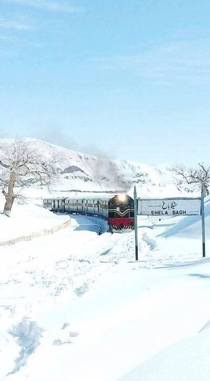 Snowy Train Track in Pakistan.. Snow Winter Cold Temperature Blue Nature Tourism Travel Destinations Outdoors Frozen Polar Climate Day Beauty In Nature Mountain No People Landscape Snowing Tree Sky Snowy Days... Snowy Trees Train Tracks Pakistani Traveller Pakistan Eye Em Nature Lover Eye For Photography