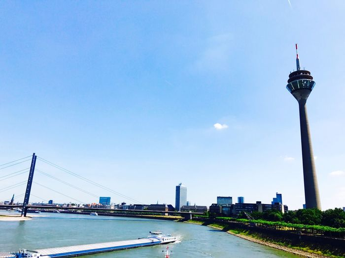 Architecture Built Structure Transportation Building Exterior City Tower Travel Destinations Outdoors Copy Space Travel Sky Day Bridge - Man Made Structure Skyscraper No People Suspension Bridge Cityscape Blue Water Urban Skyline Rheinufer Rhein Rhine Düs