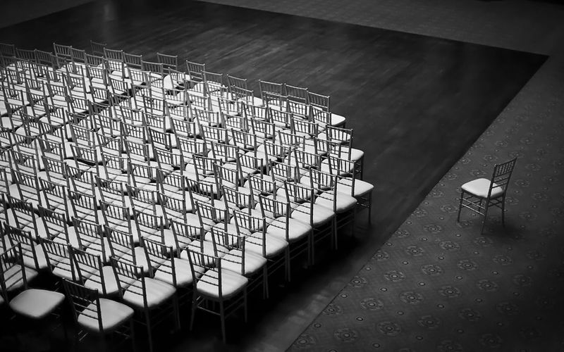 High Angle View Of Empty Chairs On Floor In Auditorium