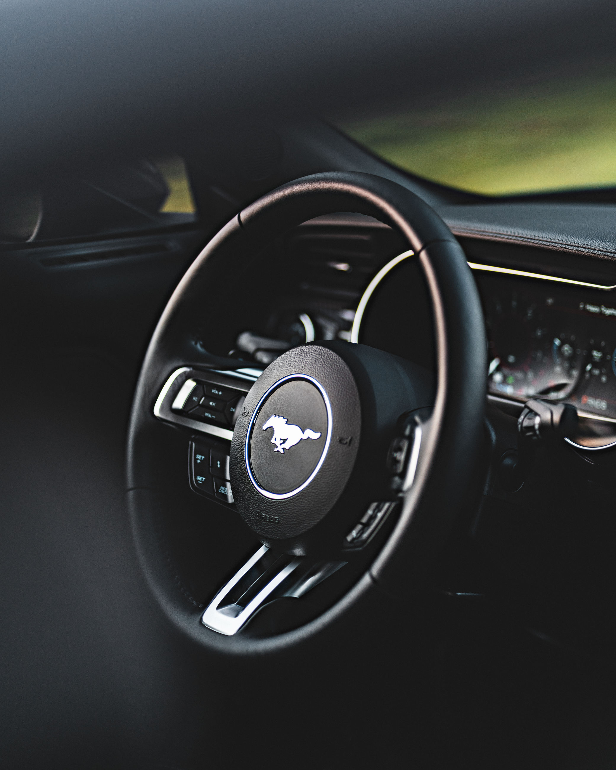 car, vehicle, land vehicle, mode of transportation, motor vehicle, transportation, car interior, vehicle interior, control panel, automobile, dashboard, luxury vehicle, speedometer, sports car, indoors, close-up, steering wheel, speed, wheel, black, gear shift, no people, technology, control, family car, luxury, vehicle part