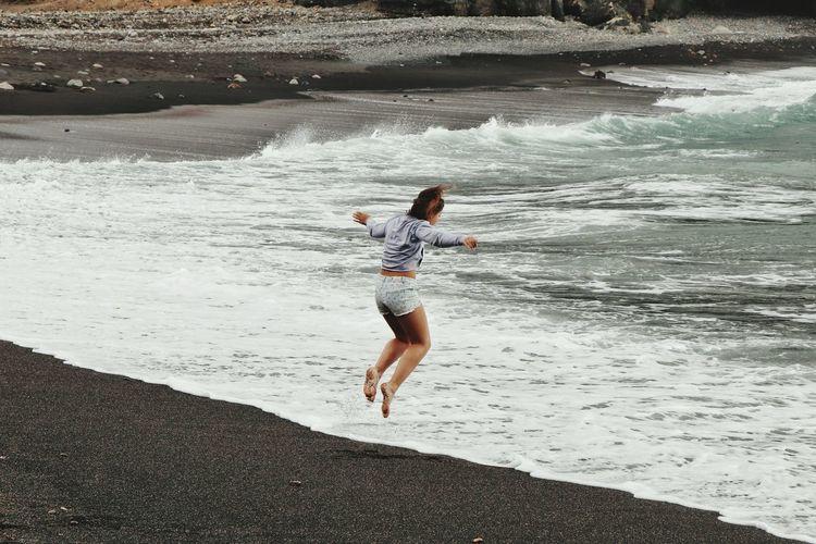 Woman jumping at beach