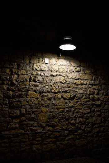 Capture Tomorrow EyeEmNewHere Lighting Equipment Illuminated Wall Brick Brick Wall Indoors  No People Night Electric Lamp Wall - Building Feature Dark Light Electricity  Light - Natural Phenomenon Electric Light Textured  Light Bulb Architecture Glowing Low Angle View Ceiling