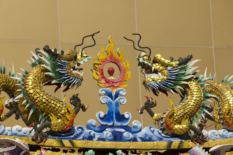 Golden dragon statue in Chinese temple Chinese Temple Ancient Architecture Golden Dragon Statue Architecture Art And Craft Belief Chinese Dragon Chinese Temple Chinese Temple Decoration Craft Creativity Dragon Dragon Statue Dragon Statues Golden Dragon Golden Dragon Fly Golden Dragonfly Idol Ornate Religion Sculpture Statue
