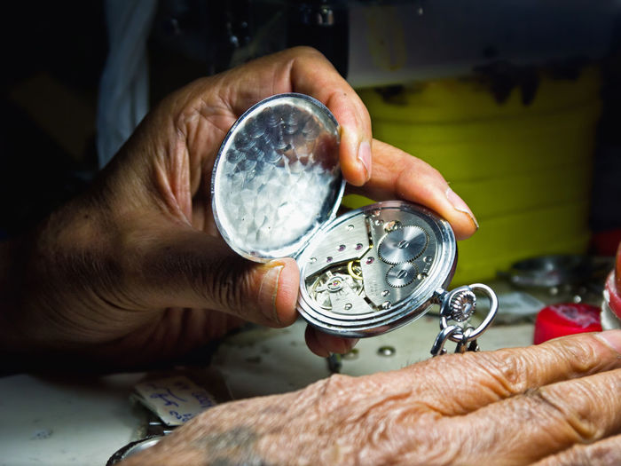 Handmade For You Watchman Watchmaker Watchmania Watchmaking Human Hand One Man Only Holding Examining Human Body Part People Clock Hour Watch Focus Focus Object Shadow Spotlight Slowly Art And Craft Craft Art Close-up Table Workplace Business Stories Small Business Heroes