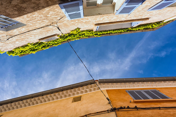 Summer blue Architecture Blue Sky Building Exterior Built Structure City Square Colored Facades Connection Contrast Day House Look Up Low Angle View Mediterranean  No People Old Town Outdoors Provence Sky South Of France Urban Window Winter