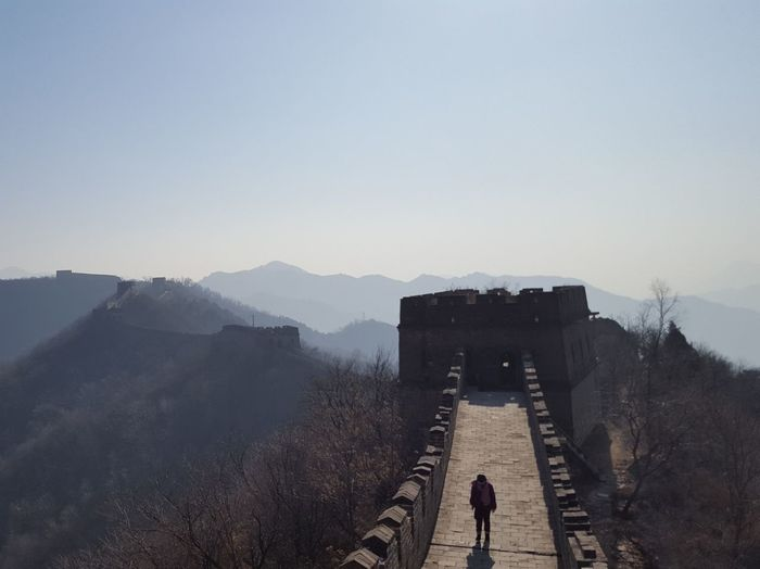 High angle view of silhouette person walking on great wall of china against clear sky