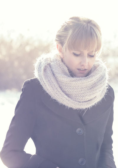 Winter Lady Bangs Beautiful Woman Blond Hair Casual Clothing Clothing Cold Temperature Day Front View Hairstyle Leisure Activity Lifestyles Nature One Person Outdoors Portrait Real People Scarf Smiling Sunlight Waist Up Warm Clothing Winter Women A New Beginning