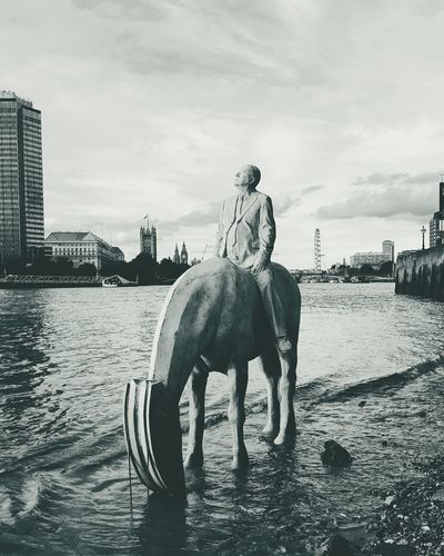 The amazing Risingtide Sculpture in Thethames London with views of Bigben Westminster Housesofparliament LondonEye Thames