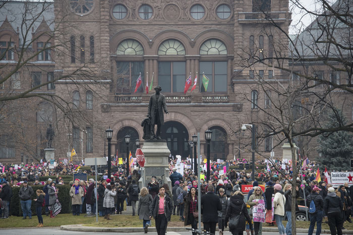 Crowd in front of Queen's Park. Women's Solidarity March in Toronto, Canada. January 21, 2017 marked the history of the capital city of Ontario with one of the largest protest march gathering more than 60,000 people. Women were claiming more social justice and protesting many of Donald Trump stances. Anti-trump Architecture Building Exterior Built Structure Canada Canadian Demanding  Democracy Freedom Girls Large Group Of People Leftist March Movement Ontario People Power Revolution Signs Social Justice Symbols Toronto Toronto Canada Women's March Women's Solidarity March