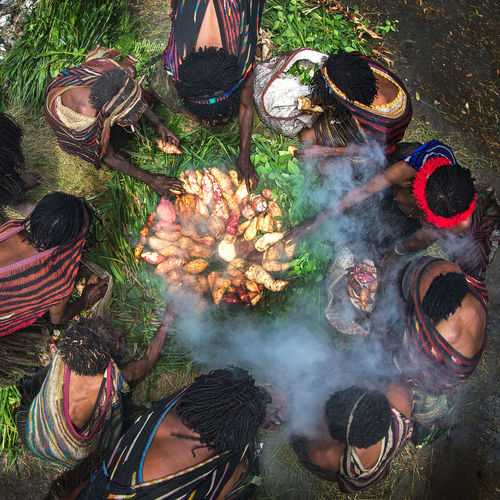 High angle view of people cooking