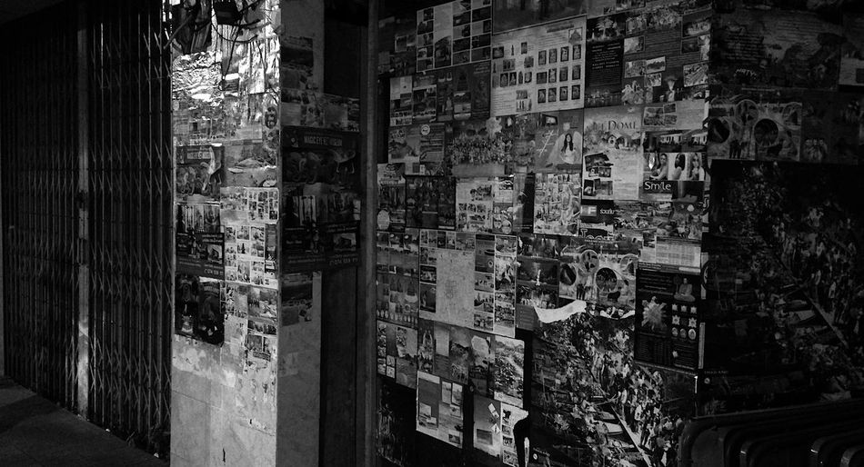 Advertisement Posters After Dark Stickers Abundance Alley Architecture Arrangement Building Building Exterior Choice City Closed Shop Collection Communication Defaced Illuminated Large Group Of Objects Night No People Posters Posters Wall Shopfront Store Wall - Building Feature